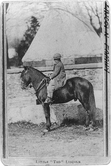 Tad Lincoln on pony between 1860 and 1865